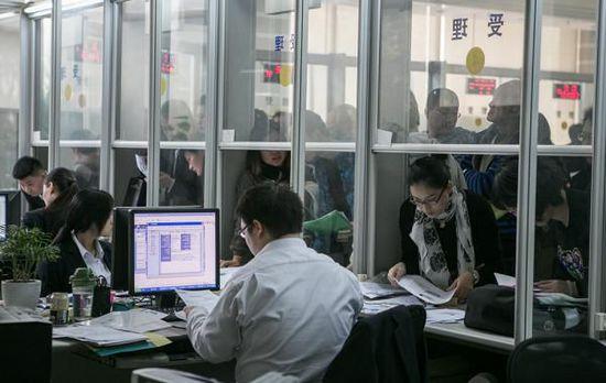 李克强按期签发不动产登记条例 明年三月施行